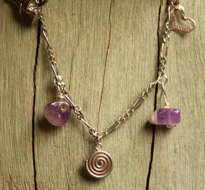 397. Amethyst and 925 Silver Charm Bracelet